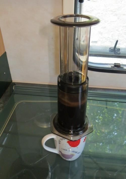 Invert the Aeropress onto a mug, and press gently but firmly. Air pressure expresses the coffee through the filter.
