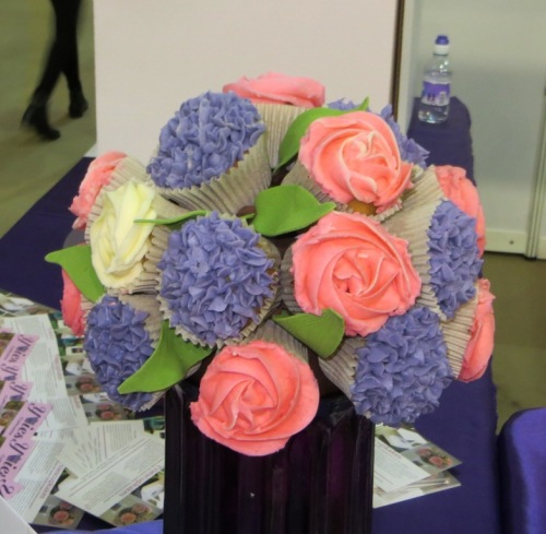 A floral bouquet made out of cupcakes by Yvies Cupcakes