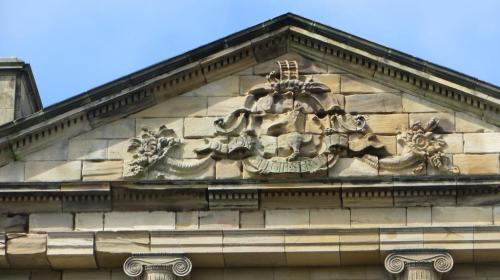 The coat of arms of the Grey family, showing the scaling ladder at the top which is their famous mark