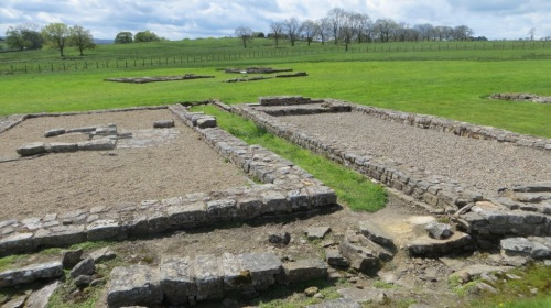 Where the archaeologists have already excavated, the outline of the Roman buildings has been restored.