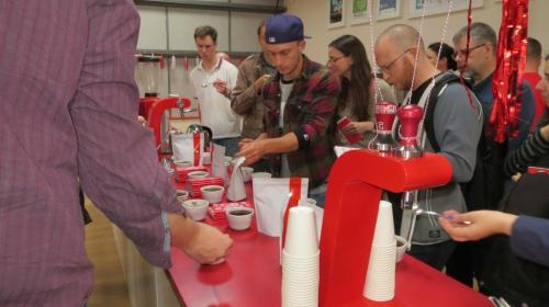 The open day guests practising their cupping skills